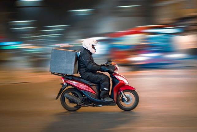 Food Delivery Man on speed on motobike